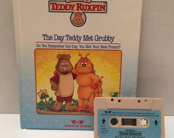 Teddy Ruxpin The Day Teddy Met Grubby book with cassette tape.