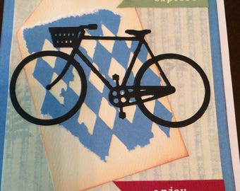 Bicycle themed handmade card, multi paper layers in blues and greens, adventure, explore, enjoy