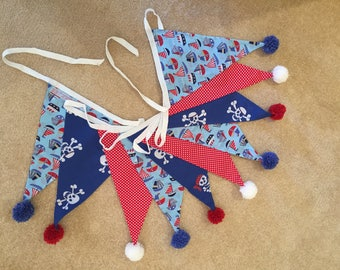 Nautical bunting with pom pom trimmed flags