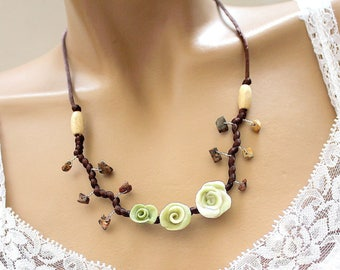 Green necklace three cold porcelain flowers