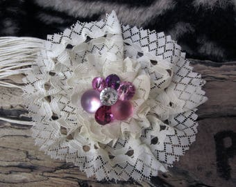Flower brooch with white lace at the heart of rhinestones