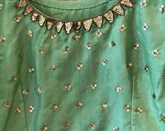 Green organza silk sari with silk embroided blouse.