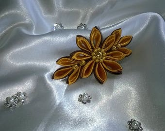 Barrette with flower made of gold and chocolate with a Pearl filagranee heart and small satin ribbon pearls gold