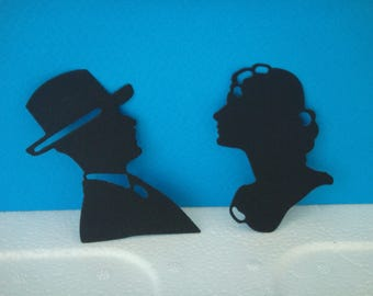 Cut black silhouette of couple for scrapbooking and card