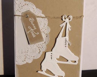 Christmas new year's Eve, kraft color and white card with ice skates