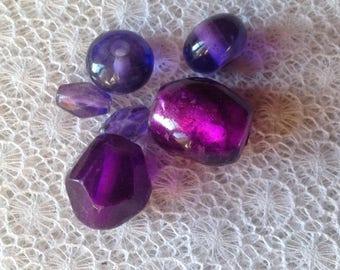 Set of six purple-violet color glass beads