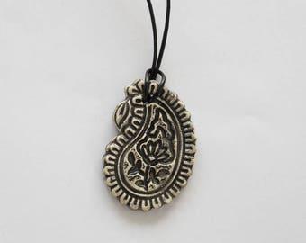 Oval shape, black flower print ceramic pendant