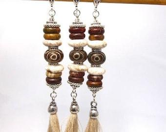 1 Tibetan dzi bead and heishi beads on stem with tassel