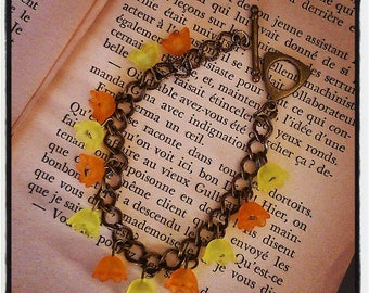 yellow and orange metal flower charm bracelet bronze