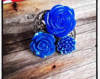 Ring bronze cabochon blue flower