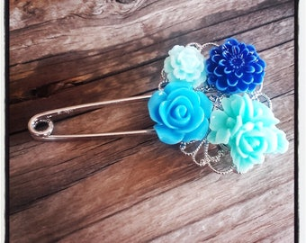 Silver filigree pin and blue flowers