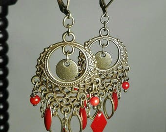 red beads and sequins and bronze earrings