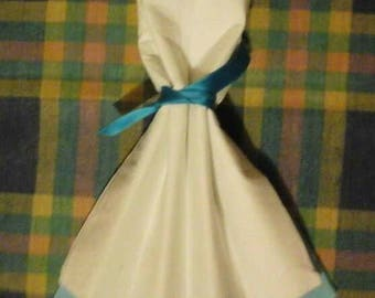 Towel folding in the shape of white and blue dress