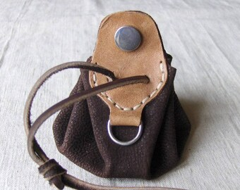 Coin purse is brown-beige leather