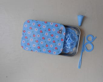Blue metal box containing the knitting accessories