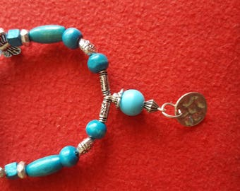 Turquoise beads and silver charms bracelet