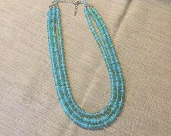 Multi-row necklace turquoise blue Opal quartz beads.