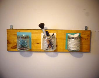 Wooden wall rack with jars
