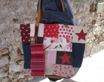 large tote of denim and canvas in red tones with packaging