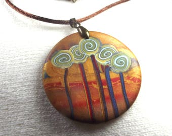 Necklace: trees Sun at sunset.