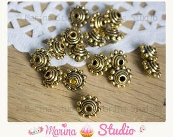 10 beads 10x7mm gold gilt antique bali type