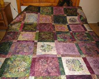 Custom quilt, shades of green and purple batiks