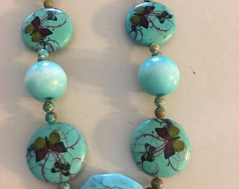 Butterfly Delight. Turquoise necklace with hand painted butterflies. Such a beautiful unique necklace.