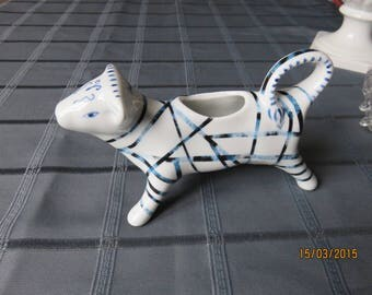 A cow on the table! A Creamer or gravy boat decorated porcelain.