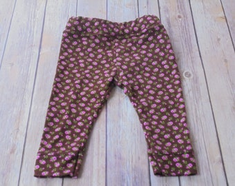 Brown leggings with rose print