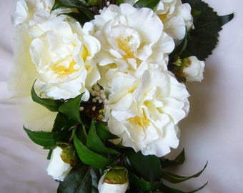 bouquet of bride, white gardenias and Daffodil tulle