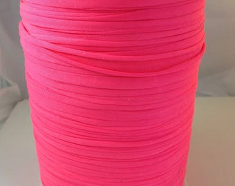 Large spool of Trapilho neon pink stretch lycra jersey
