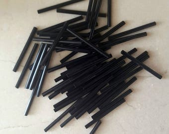 set of 50 beads black tube 34 mm