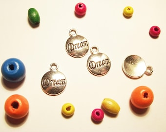 "2 ""dream"" metal charms"