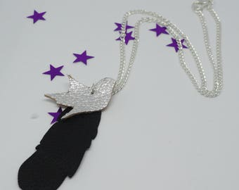 Necklace adorned with a faux leather silver bird pendant and its large black feather