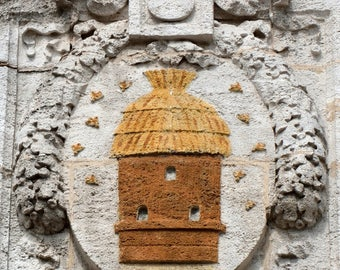 Beehive emblem on the front of a House of Rochefort on sea