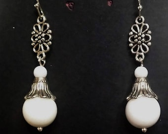 Earrings trumpets and filigree white onyx