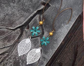 Large dangle earrings bronze, blue flowers, small Golden magic beads charms and white filigree leaves.
