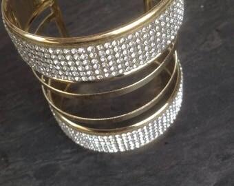 Large rhinestone gold plated cuff.