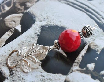 Faceted red coral ball and metal leaf pendant