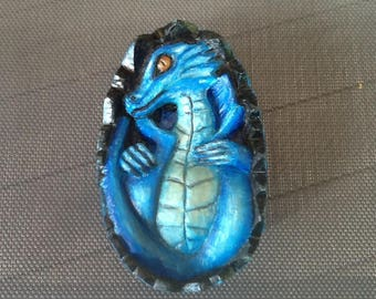 Wooden blue dragon egg sculpture. Baby dragon in his egg.