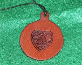 Leather with a heart design pendant