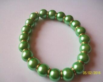 green glass bead bracelet-ringed gold