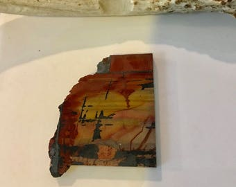 Indian Paint Rock preform cabochon. 36 x 41 x6.5