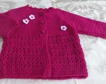 Small crocheted flowers and pink jacket