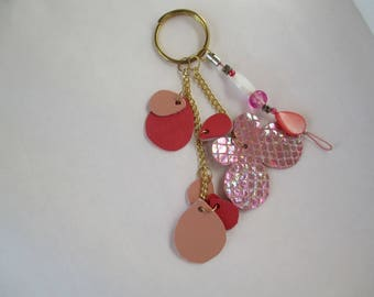 Pink leather handbag with gold chain and beads
