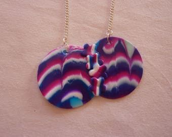 a double strand necklace round marbled floral