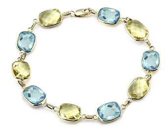 14K Yellow Gold Gemstone Bracelet With Cushion Cut Blue Topaz And Lemon Quartz Link Stations