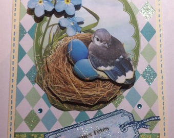 Card 3D Easter eggs and bird nest, blue flowers