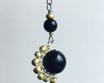 Stylish black and gold sunshine dangle and drop earrings (also available in brown)