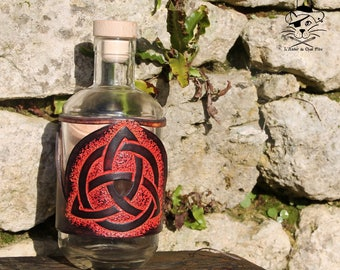 Bottle covered with leather - Triquetra